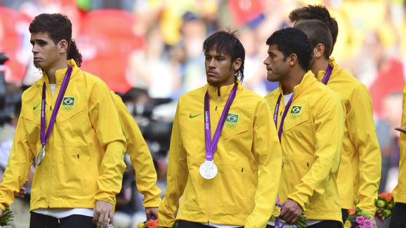 Brazil's Neymar leaves with his silver m