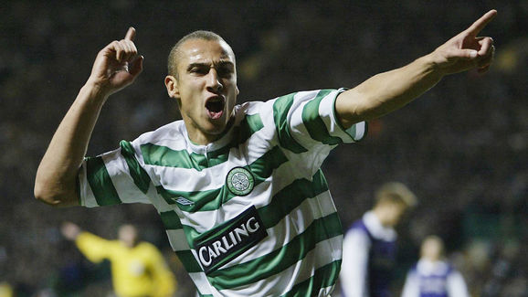 Henrik Larsson of Celtic celebrates scoring