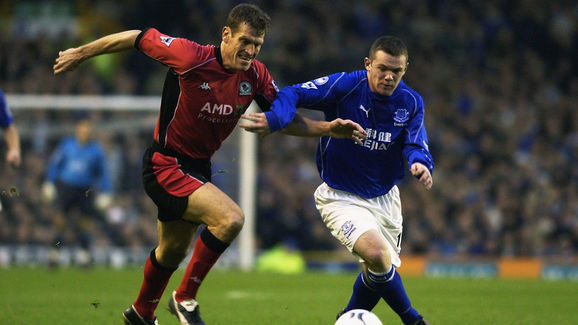Craig Short of Blackburn Rovers tussles with Wayne Rooney of Everton for possession of the ball