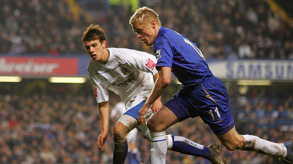 Chelsea's Damien Duff (R) clashes with A