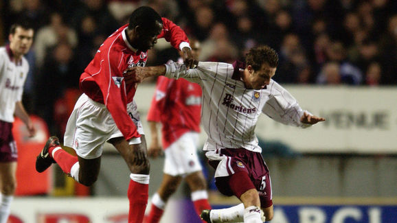 Lee Bowyer of West Ham United shields the ball from Richard Rufus of Charlton Athletic