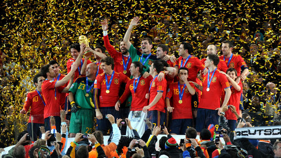 Spain's players hold the trophy during t