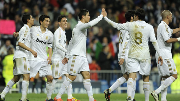 Real Madrid's players celebrate after sc
