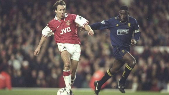 Paul Merson of Arsenal challenged by Robbie Earle