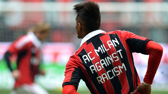 AC Milan's Ghanaian forward Prince Kevin Boateng, wearing a jersey against racism