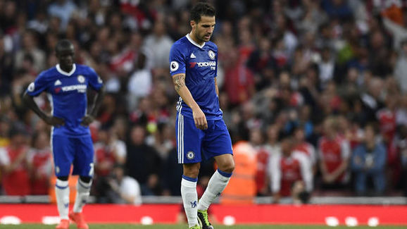 Cesc Fabregas [R] against his former club Arsenal