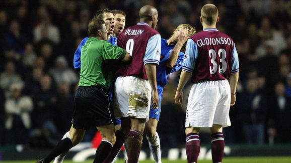 Dion Dublin of Aston Villa loses his cool as he head butts Robbie Savage of Birmingham City