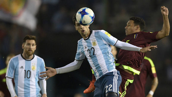 Argentina's Javier Pastore and Venezuela's Arquimedes Figuera (R) vie for the ball during their 2018 World Cup qualifier
