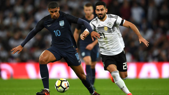 Ruben Loftus-Cheek of England and IIkay Gundogan of Germany battle for possession