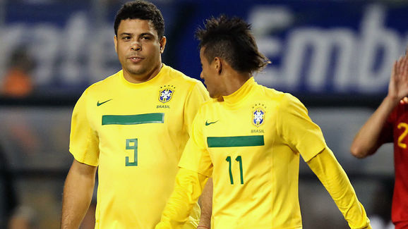 Brazil's Ronaldo Nazario (L) walks next