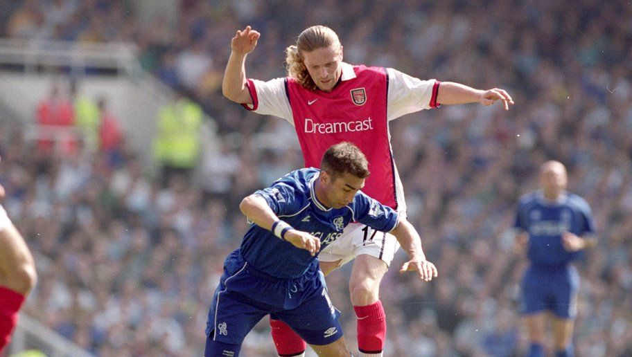 6 May 2000:  Emmanuel Petit of Arsenal (standing) challenges Roberto Di Matteo of Chelsea during the FA Carling Premiership game at Highbury in London, England. Arsenal won 2 - 1. \ Mandatory Credit: Ben Radford /Allsport