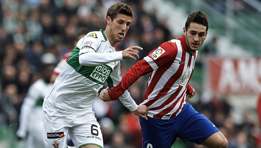 ELCHE, SPAIN - NOVEMBER 30: Ruben Perez (L) of Elche competes for the ball with Koke of Atletico de Madrid during the La Liga match between Elche FC and Atletico de Madrid at Estadio Manuel Martinez Valero on November 30, 2013 in Elche, Spain.  (Photo by Manuel Queimadelos Alonso/Getty Images)