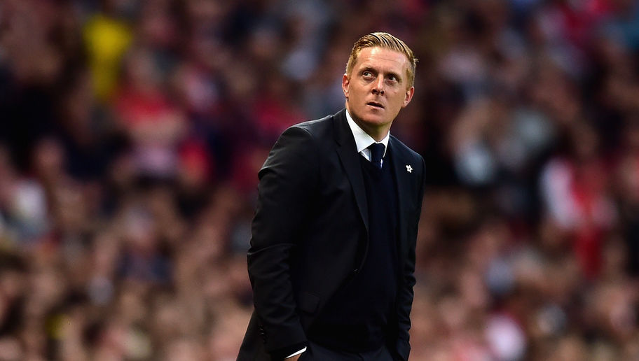 LONDON, ENGLAND - MAY 11: Manager Garry Monk of Swansea City looks on  during the Barclays Premier League match between Arsenal and Swansea City at Emirates Stadium on May 11, 2015 in London, England.  (Photo by Jamie McDonald/Getty Images)