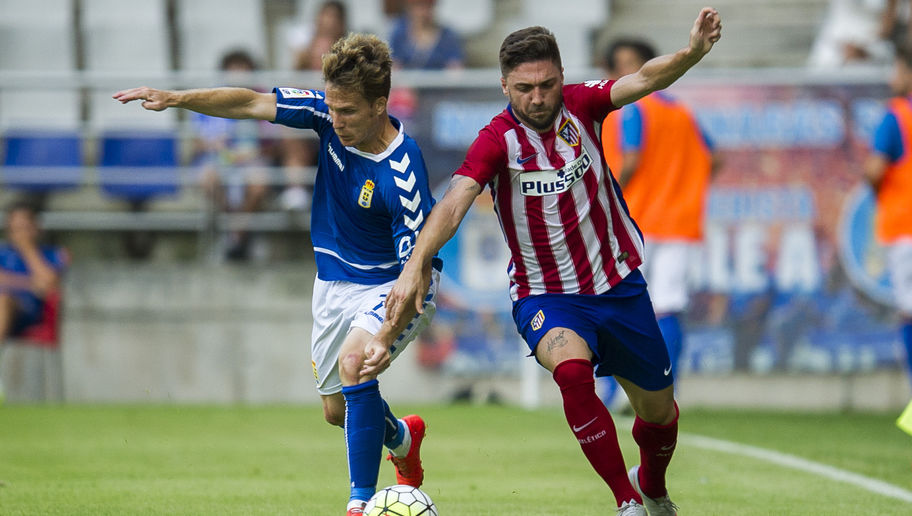 OVIEDO, SPAIN - JULY 28:  Guilherme Siqueira of Club Atletico de Madrid duels for the ball with Susaeta of Real Oviedo during a pre season friendly match between Real Oviedo and Club Atletico de Madrid at Carlos Tartiere on July 28, 2015 in Oviedo, Spain.  (Photo by Juan Manuel Serrano Arce/Getty Images)