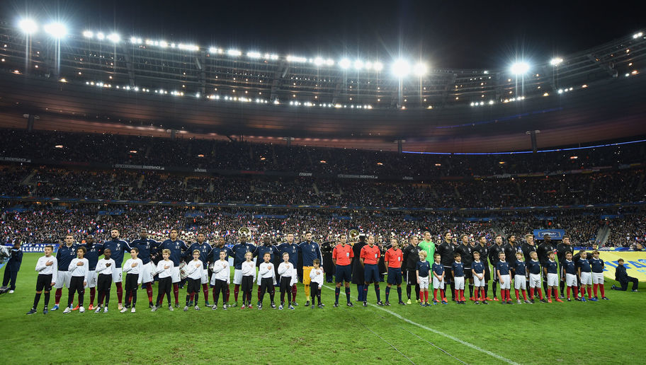 PARIS, FRANCE - NOVEMBER 13:  The teams of France and Germany line up prior to the International Friendly match between France and Germany at the Stade de France on November 13, 2015 in Paris, France.  (Photo by Matthias Hangst/Bongarts/Getty Images)