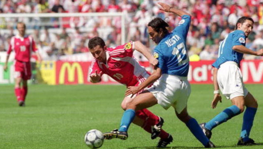 11 Jun 2000:  Sergen Yalcin of Turkey is challenged by Alessandro Nesta of Italy during the European Championships 2000 group match at the Gelredome in Arnhem, Holland.  Italy won the match 2-1. \ Mandatory Credit: Shaun Botterill /Allsport