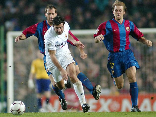 Portuguese Real Madrid's Luis Figo (C) vies betwen