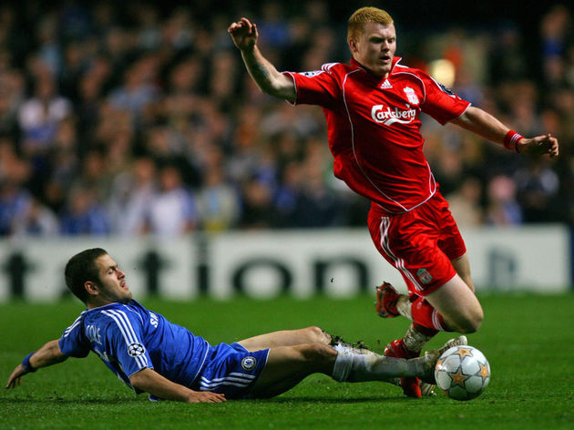 Liverpool's John Arne Riise (R) is tackl