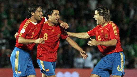 Spain's Xavi Hernandez (C) celebrates af