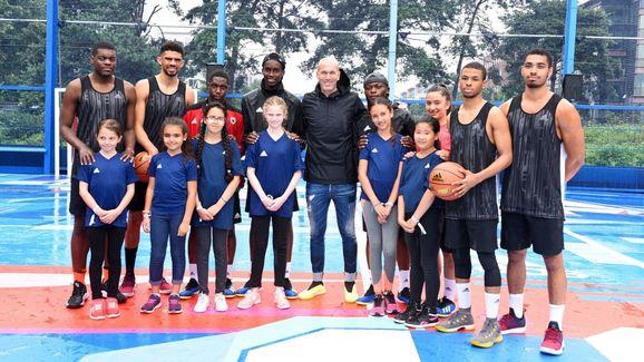 Zinedine Zidane with locals at the ZZ10 playground in Paris