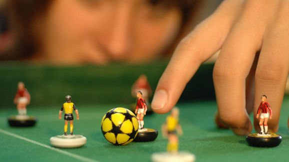 A subbuteo player kicks one of her ten m