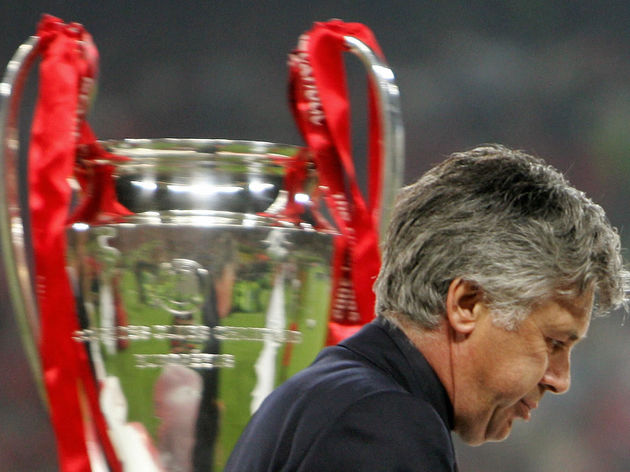 AC Milan's coach Carlo Ancelotti walks b