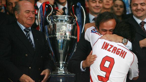 AC Milan's forward Filippo Inzaghi hugs...