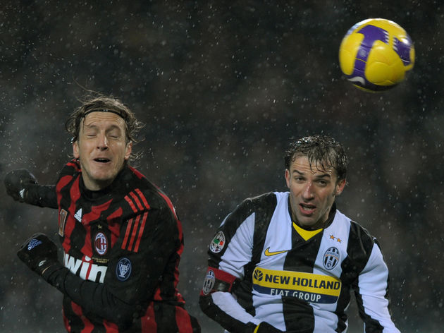 AC Milan's Massimo Ambrosini (L) eyes th