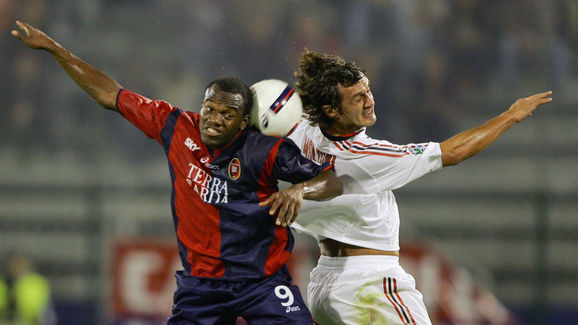 AC Milan's Paoloo Maldino (R) jumps for