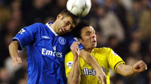 Chelsea's Adrian Mutu (L) jumps for a he