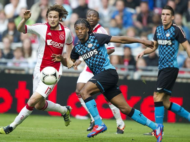 Ajax Amsterdam's player Dailey Blind (L)