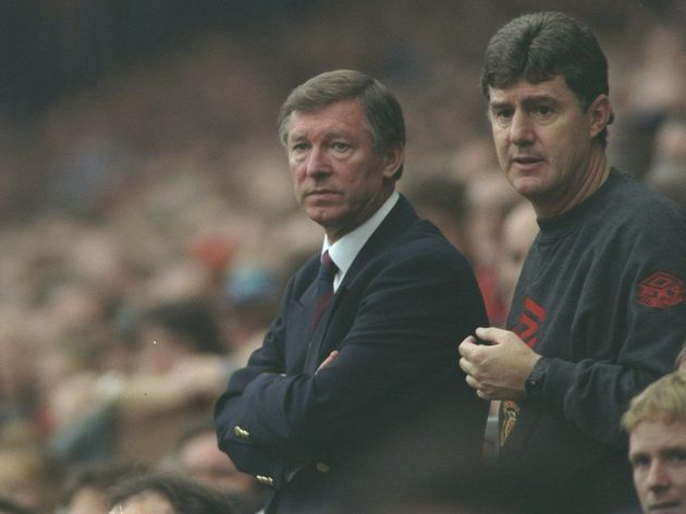 Alex Ferguson (left) the manager of Manchester United stands next to his assistant coach Brian Kidd