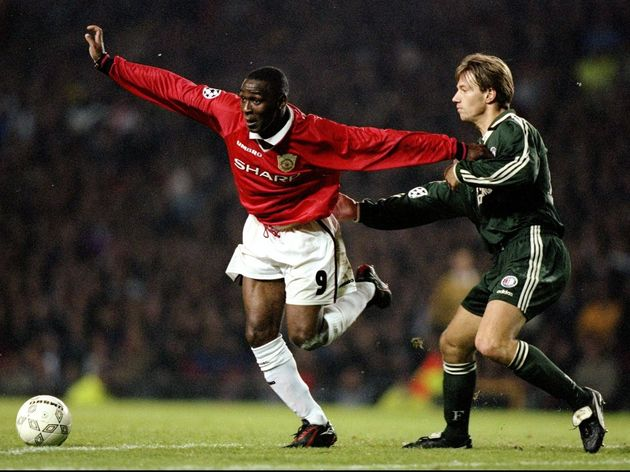 Andy Cole of Manchester United and Bernard Schuiteman of Feyenoord