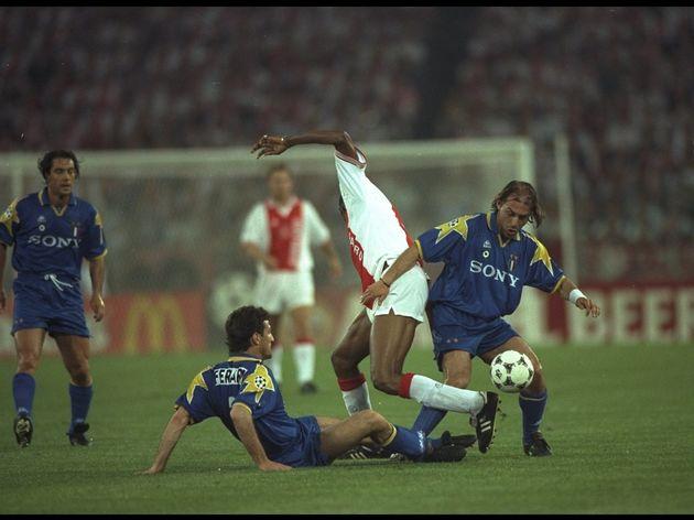 Antonio Conte and Ciro Ferrera of Juventus challenge Nwankwo Kanu of Ajax