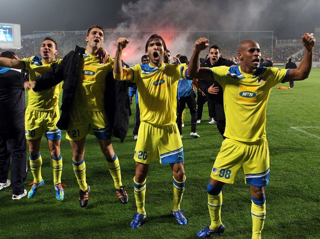 Apoel players celebrate after winning th