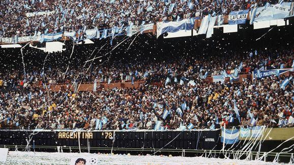 Argentinian fans throw rolls of paper al