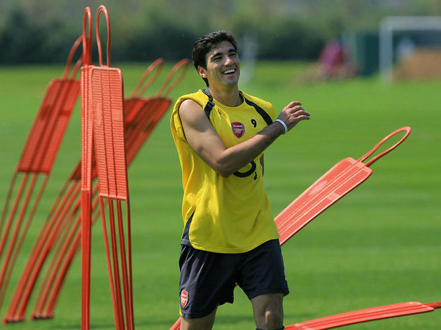 Arsenal players Jose Antonio Reyes laugh
