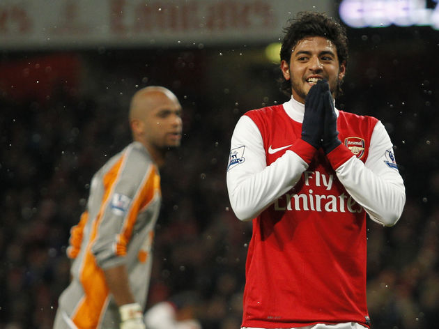 Arsenal's Carlos Vela gestures after see