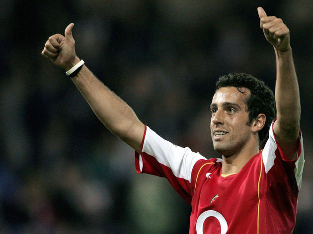 Arsenal's Edu celebrates scoring his goa