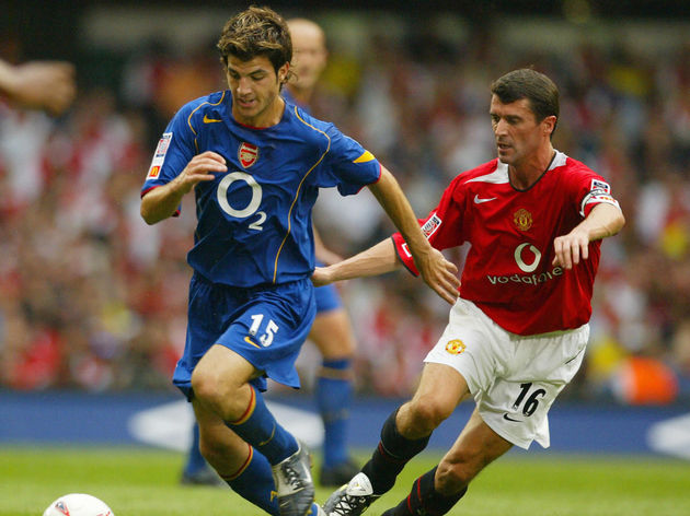 Arsenal's Francesc Fabregas (L) keeps th