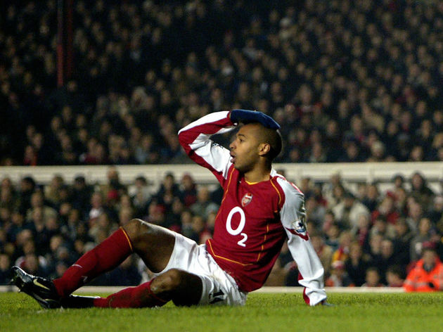 Arsenal's Thierry Henry holds his head a