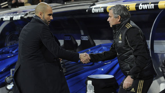 Barcelona's coach Josep Guardiola (L) an