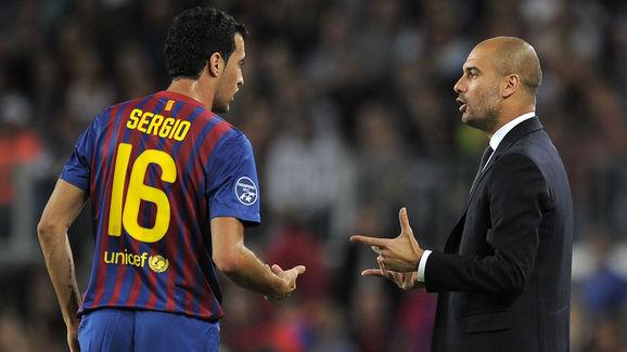 Barcelona's coach Josep Guardiola (R) ta