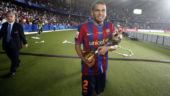 Barcelona's Dani Alves holds the 2009 FI