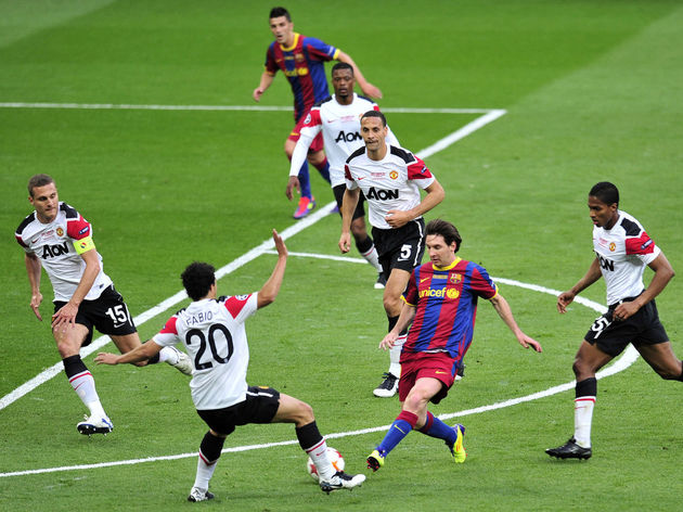 Barcelona's Lionel Messi (2nd R) vies wi