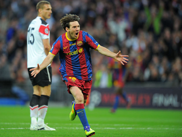 Barcelona's Lionel Messi (R) celebrates