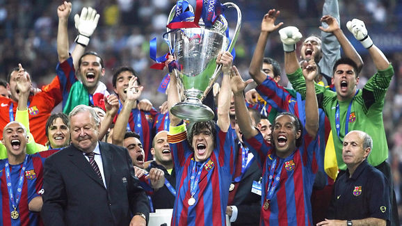 Barcelona's players hold the trophy afte