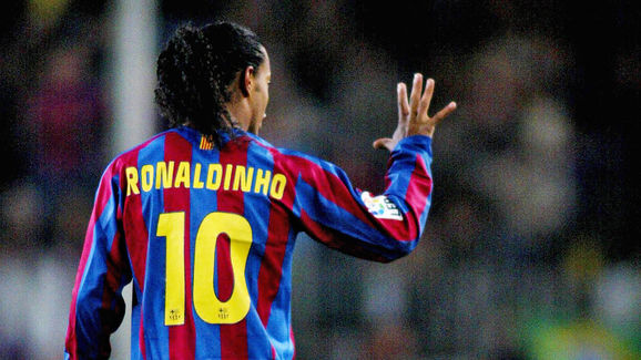 Barcelona's Ronaldinho of Brazil signs a