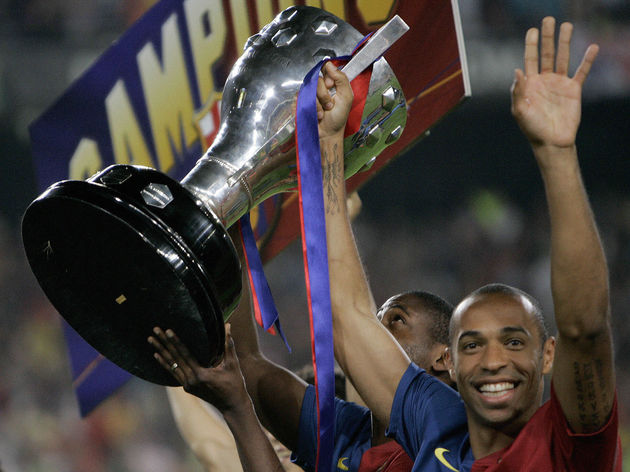 Barcelona's Thierry Henry of France carr