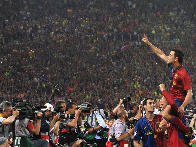 Barcelona's Xavi Hernandez (top) celebra